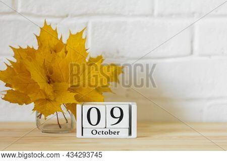 October 9 On The Calendar And A Bouquet Of Bright Autumn Leaves On The Table.one Of The Days Of The