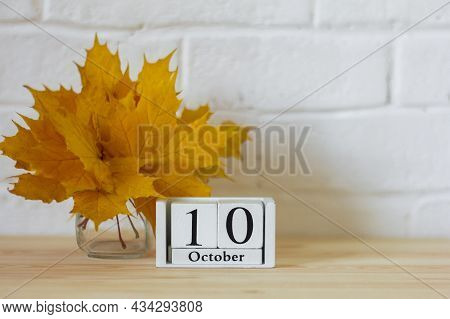 October 10 On The Calendar And A Bouquet Of Bright Autumn Leaves On The Table.one Of The Days Of The