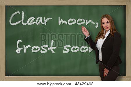 Teacher Showing Clear Moon, Frost Soon On Blackboard