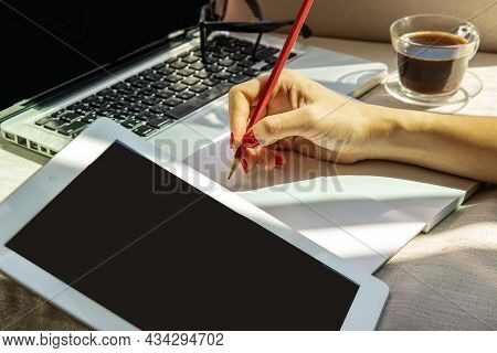 Hand Of Business Woman Writing On Paper At Her Workstation. Business Concept. No Focus, Specifically