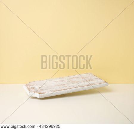 Rectangular Empty White Wooden Kitchen Board On Yellow Background, Utensils