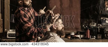 Hairdresser Cutting Hair Of Male Client. Hairstylist Serving Client At Barber Shop. Man Visiting Hai