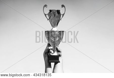 Winner, Win, Champions Cup, Prize. Winners Holding Champion Golden Trophies. Hand Of The Person With