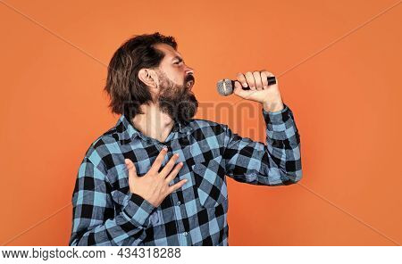 Music Is The Answer. Male In Karaoke. Music And Vocal Concept. Bearded Man In Checkered Shirt With M