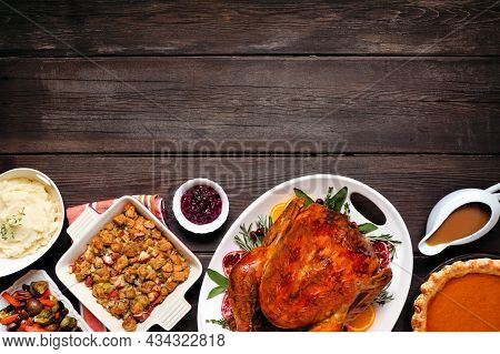 Traditional Thanksgiving Turkey Dinner. Top View Bottom Border On A Dark Rustic Wood Background With