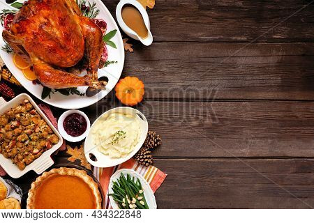 Classic Thanksgiving Turkey Dinner. Top Down View Side Border On A Dark Wood Background With Copy Sp