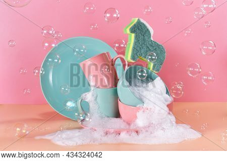 Creative Still Life In Bright Colors With A Sponge In The Shape Of A Unicorn. The Unicorn Will Say T