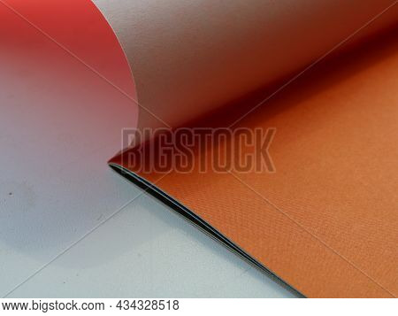 Set Of Colored Paper Opened On The First Orange Sheet, Stationery Minimalistic Background With Copy