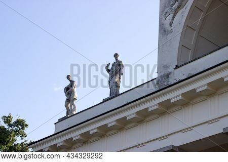 Statues Of Muses In The Temple Of Apollo. The Temple Of Apollo In Empire Style Is The Salet In The L