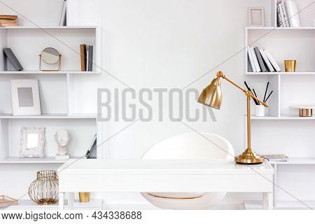 Modern Fashionable Freelance Workplace With Table, Lamp, Bookshelves. Minimalist Style Freelancer De