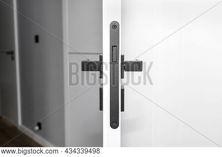 Modern White Door With Matte Black Handle And Magnetic Locks, Lock With Insert Key.