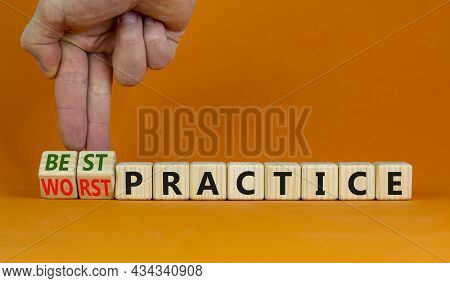 Best Or Worst Practice Symbol. Businessman Turns Wooden Cubes And Changes Words 'worst Practice' To
