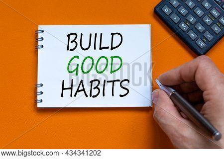 Build Good Habits Symbol. Businessman Writing Words 'build Good Habits' On White Note. Black Calcula