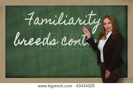 Teacher Showing Familiarity Breeds Contempt  On Blackboard