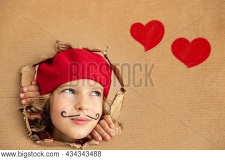 Artist Child Holding Banner Blank. Happy Kid Pretend To Be Painter. Imagination And Valentines Day C