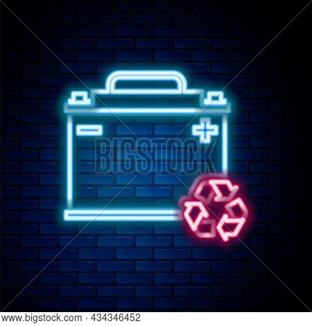 Glowing Neon Line Car Battery With Recycle Icon Isolated On Brick Wall Background. Accumulator Batte