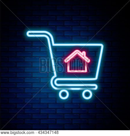 Glowing Neon Line Shopping Cart With House Icon Isolated On Brick Wall Background. Buy House Concept