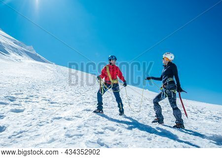 Two Laughing To Each Other Young Women Rope Team Ascending Mont Blanc Du Tacul Summit 4248m Dressed