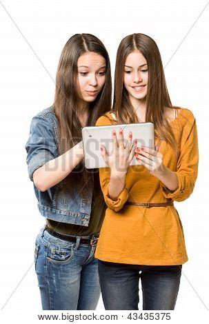 Teenagers Having Fun With A Tablet Computer.
