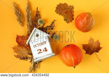 Calendar For October 24 : Decorative House With The Name Of The Month In English And The Number 24 O