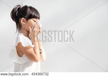 Asian Child Girl Sick With Sneezing On The Nose And Cold Cough On Tissue Paper Because Weak Or Virus