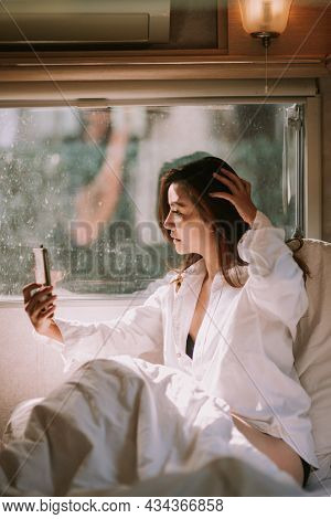 Sexy Beautiful Woman With A Smartphone In Bed