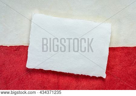 blank sheet of white handmade paper against abstract in colors of Poland  national flag - white and red, October is Polish American Heritage Month