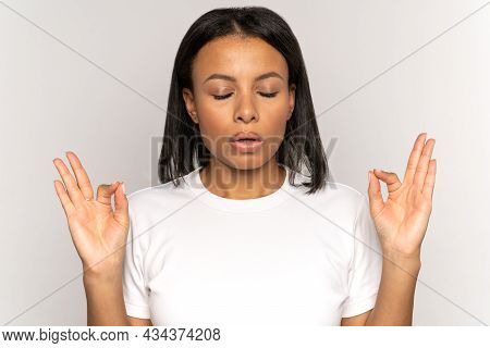 Stressed Mix Race Woman Managing Stress Breathing Deeply With Closed Eyes And Relief. Young African