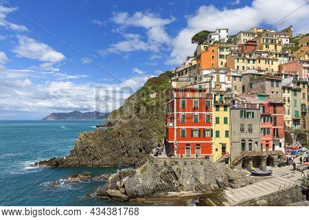 Riomaggiore, Cinque Terre - Italy, May 12, 2019: View On Seaside And Typical Colorful Houses In Smal