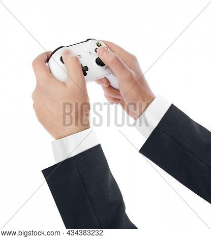 Hands and wireless gaming console gamepad - isolated on white background.