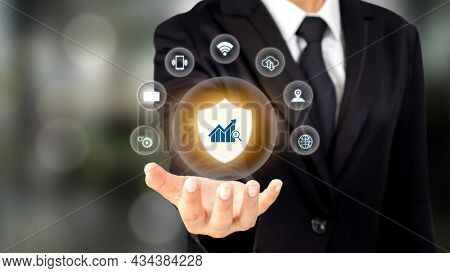 Protection Icon And Financial Business Icon In The Hands Of A Businessman With Financial Crime Preve