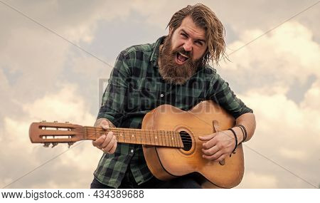 Emotional Handsome Man Singer And Guitarist. Acoustic Guitar Player. Mature Hipster Musician With Be