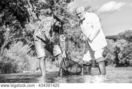 Nothing But Family. Happy Fishermen Friendship. Two Male Friends Fishing Together. Catching And Fish