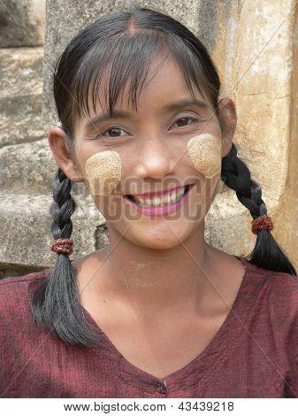 Burmese girl wears traditional thanaka as sunscreen.