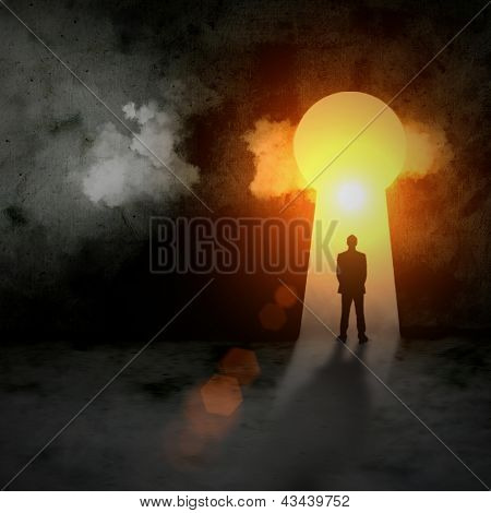 Silhouette of businessman in keyhole