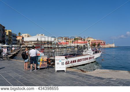 Chania, Greece - September 22, 2021: A Glass Bottom Tour Boat Anchored In The Old Harbour.