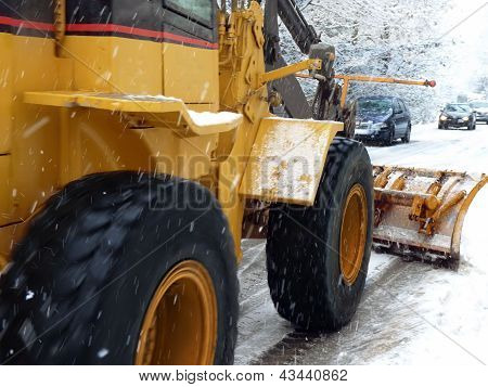 Snowplough In Winter Time