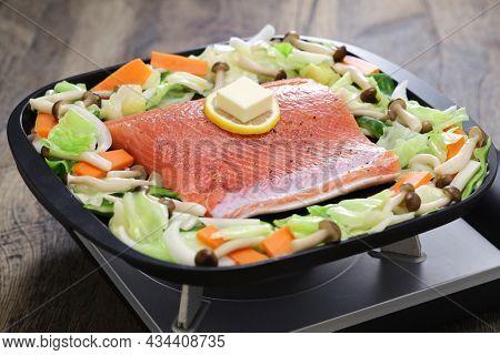 Japanese cooking; Hokkaido style salmon chanchan yaki, stir fried salmon and vegetables, seasoned with miso sauce.