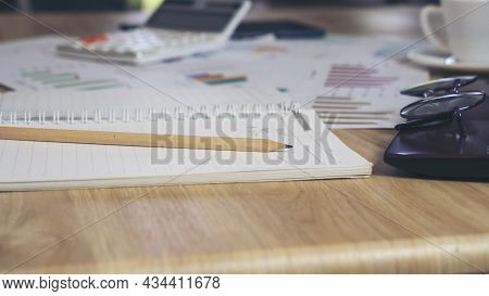 Agenda, Planner Book, Laptop, Pencil, And Cup Of Coffee Place On Office Desk. Agenda For Organizer T