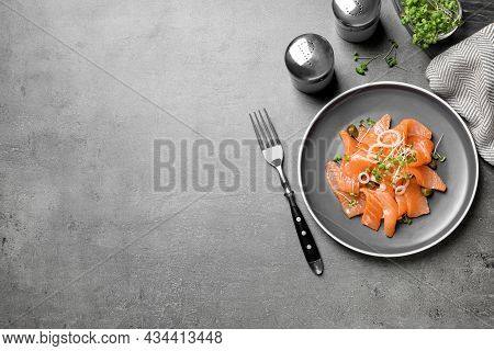 Salmon Carpaccio With Capers, Onion And Microgreens On Grey Table, Flat Lay. Space For Text