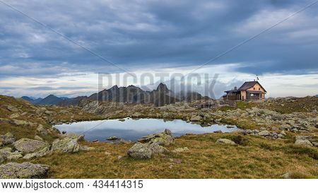 Alpine Hut Near Small Mountain Lake