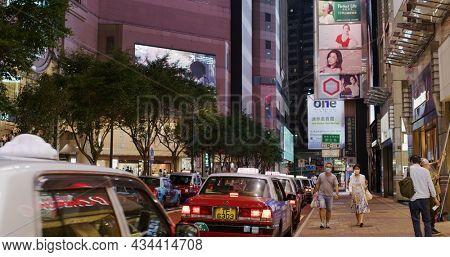 Causeway Bay, Hong Kong 30 March 2021: City street with taxi queue in Hong Kong at night