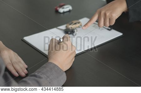The Car Dealer Provides Advice On Loans, Insurance Details, And Car Rental Information, And Delivers