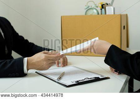 Desperately Fired Female Office Worker Employee Hands Her Employer Her Resignation Letter And Packs