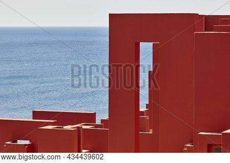 Geometric Red Building Design. The Red Wall, La Manzanera. Calpe, Spain