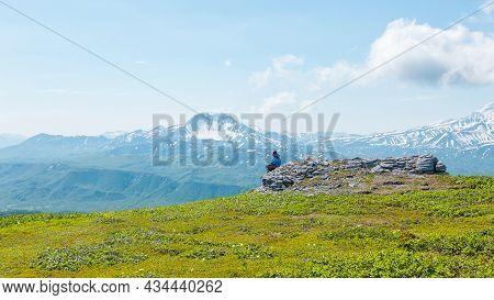 Kamchatka, Russia - July 10, 2018: Hiker Looking At The Ilyinsky Volcano, Kronotsky Reserve, Kamchat