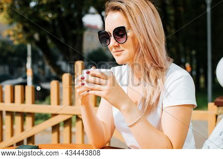 Portrait Of Beautiful Young Elegant Woman In Glasses Having Breakfast In Morning With Cup Of Coffee