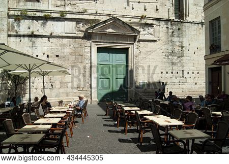 Nimes - France - April 24 2011 : Cathedral With Pavement Cafes In The Delightful Place Aux Herbes To