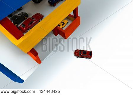 Red Toy Car Suv Pulls Up To Entrance Multi-level Wooden Garage.concept Of Finding Free Park Space In