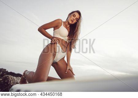 Young Beautiful Sexy Woman Posing In Sea On A Sup Board